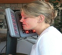 Woman using Deep Penetrating Light (DPL) Therapy System